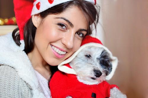 woman smiling holding dog