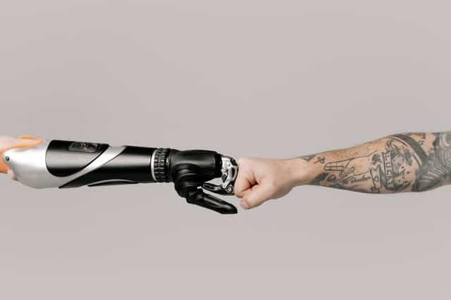 robot fist bumps human