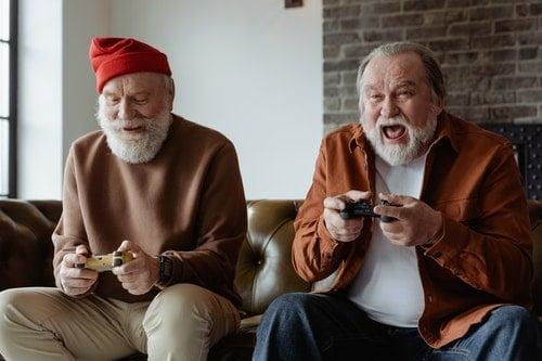 senior men playing video games